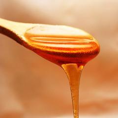 Miel dans une cuillère