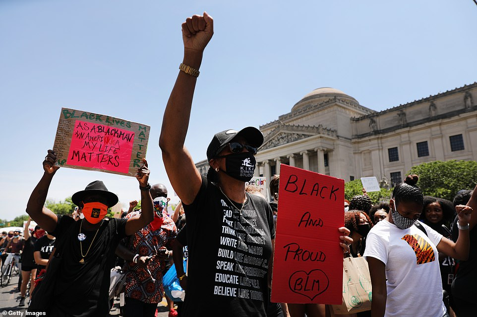 Large crowds of protesters gather in front of the Brooklyn Museum in Brooklyn to commemorate Juneteenth on Friday