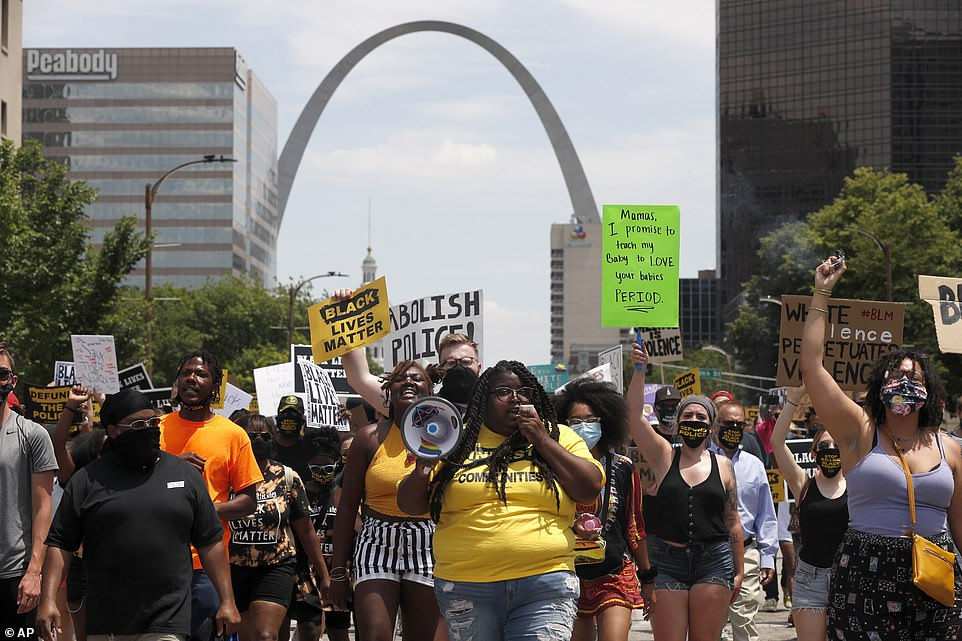 Residents in St. Louis, Missouri, gathered near The Gateway Arch on Juneteenth as they chanted and carried 'Black Lives Matter' signs through the city