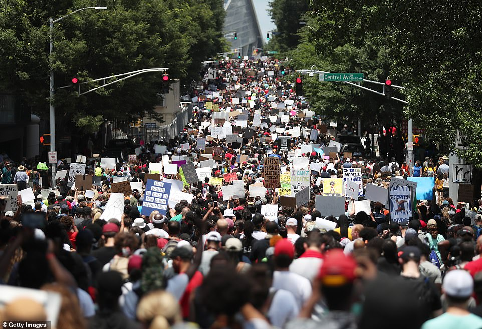 A photo taken at a Juneteeth Black Lives Matter demonstration in Atlanta, Georgia, shows the full scope of attendees as they overtake the roadway while hoisting protests signs in the air