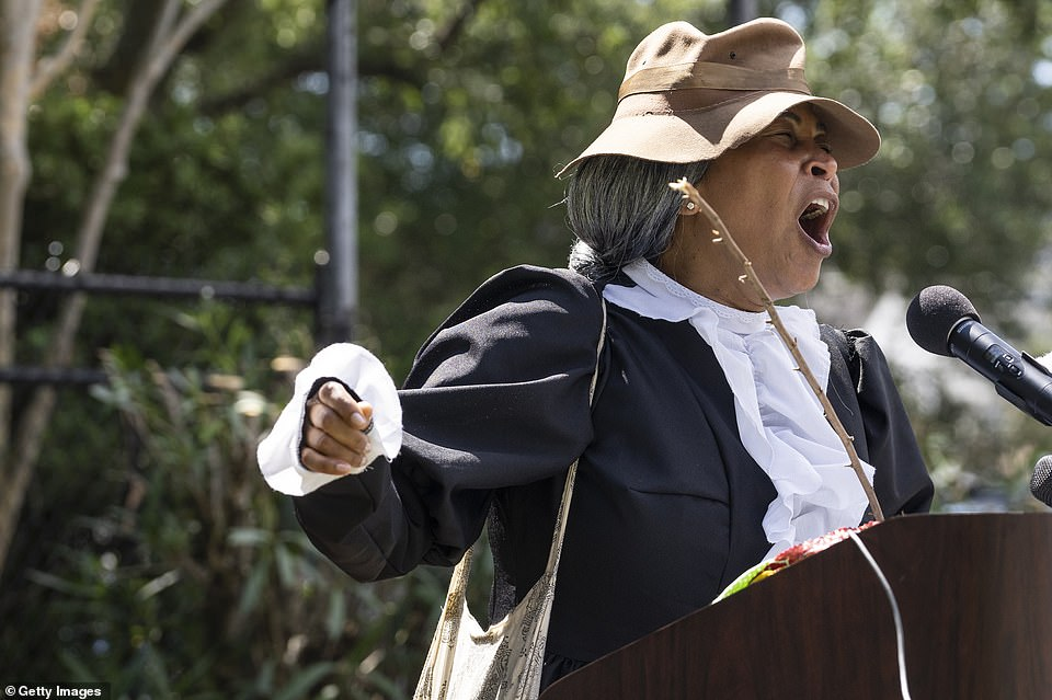 Rebecca Jimerson sings during the ceremony of the 155th anniversary of Juneteenth at historic Ashton Villa, where emancipation of the slaves was announced in 1865 (pictured)