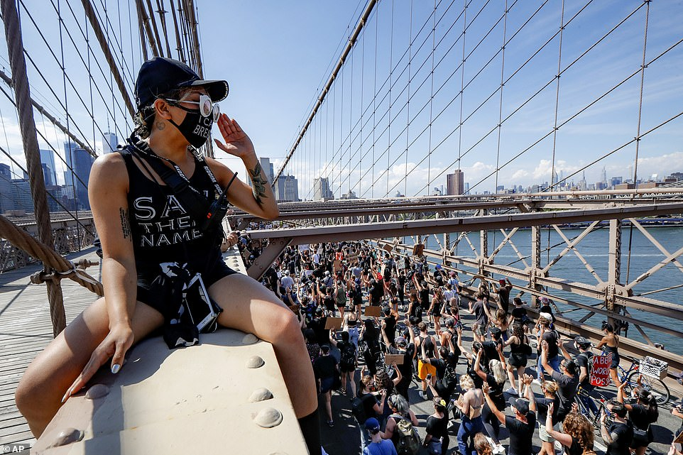 Thousands made their way across the Brooklyn Bridge on Friday as temperatures reached 80 degrees with mostly sunny skies
