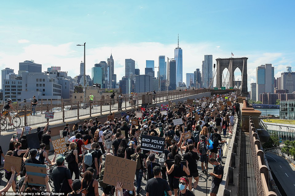 Black Lives Matter protesters are seen above crossing the Brooklyn Bridge and heading toward Manhattan to commemorate Juneteenth on Friday