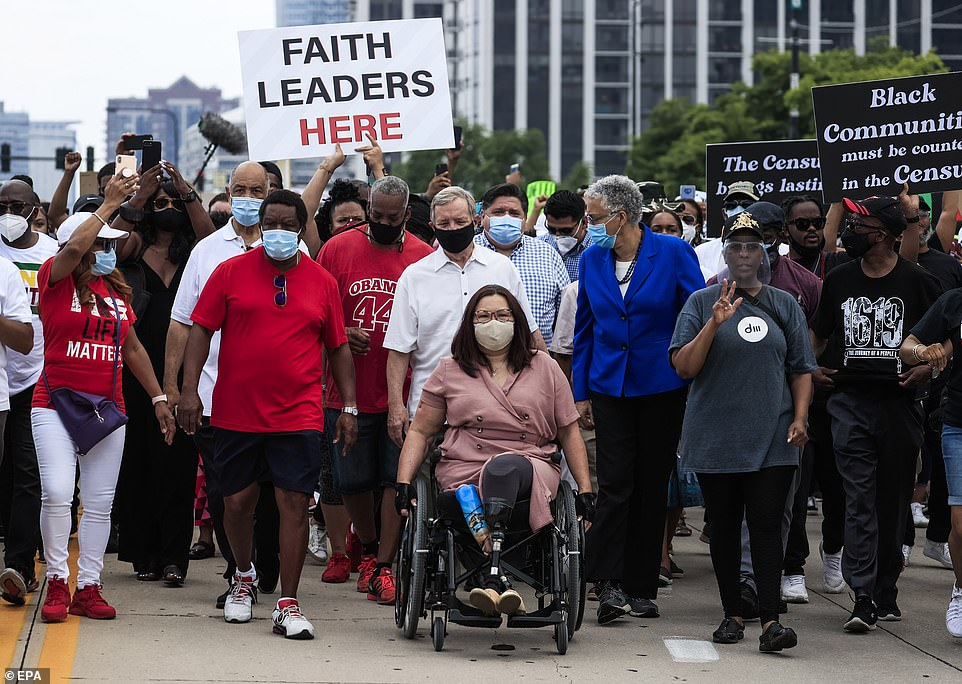 US Senator Tammy Duckworth, who lost her legs while serving in combat in Iraq, is followed by Durban, Pritzker, and other protesters in Chicago on Friday