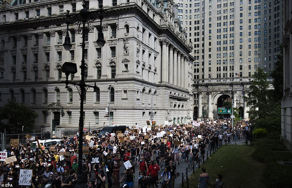 A large mass of protesters is seen in Lower Manhattan after crossing the Brooklyn Bridge on Friday