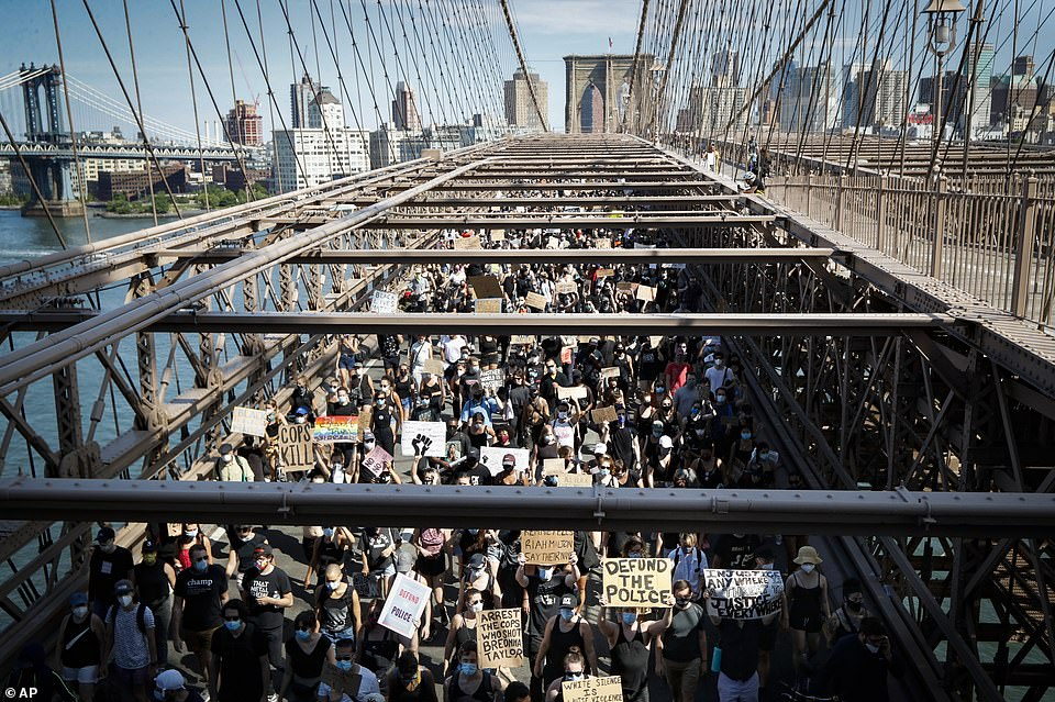 New York City on Friday formally declared Juneteenth a city holiday. Protesters are seen in the above photo on the Brooklyn Bridge