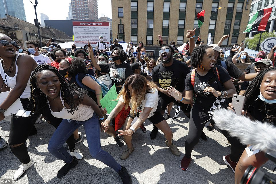 Revelers celebrate and dance during the Juneteenth events in Chicago on Friday