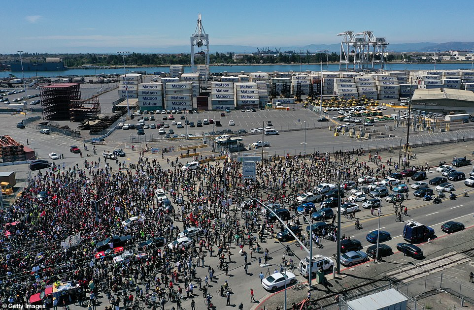 Thousands of union longshoremen and Black Lives Matter activists participated in a rally and march to observe Juneteenth at the Port of Oakland, one of dozens of ports on the west coast to shut down operations for the day